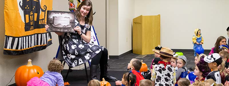 Pictures of kids listening at a Halloween story time